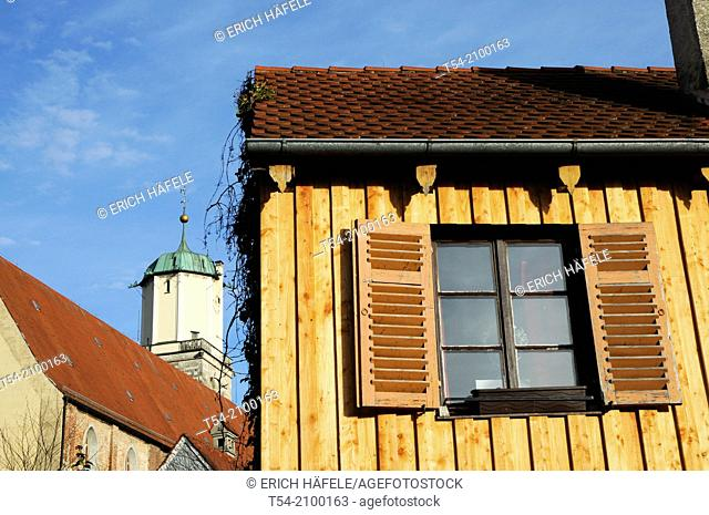 Old wooden house in front of the Saint Martin church in Memmingen / Bavaria