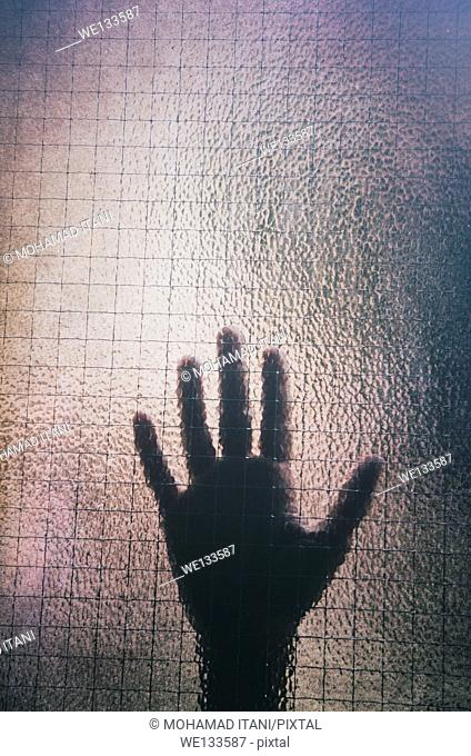Girl's hand on the glass