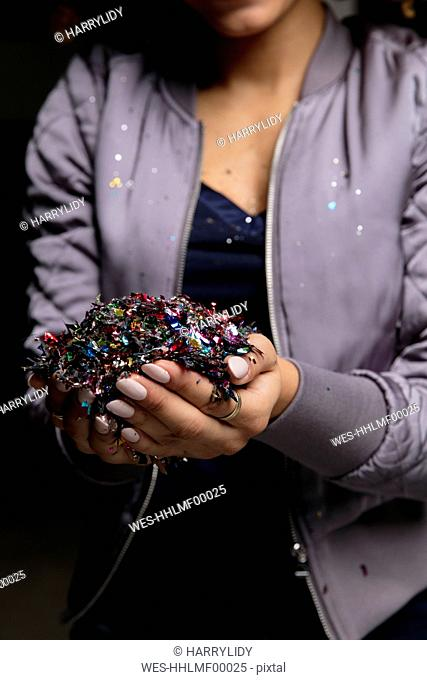Woman's hands holding confetti
