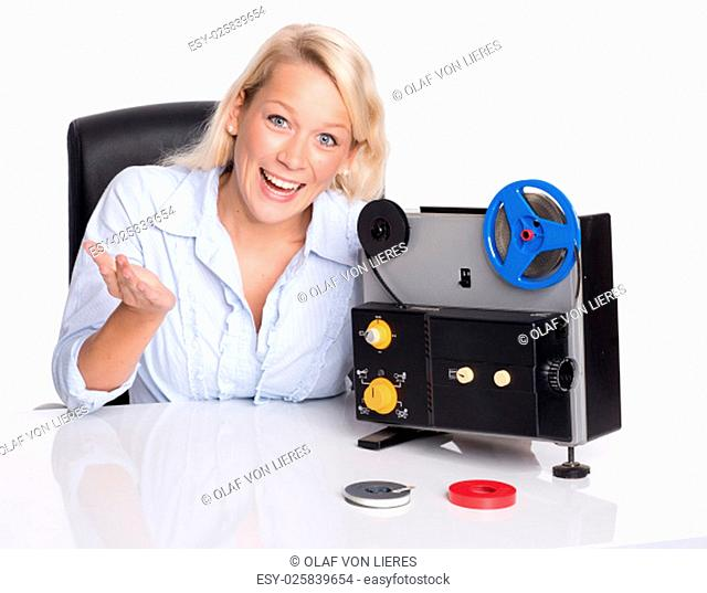 blonde woman presenting an old movie projector