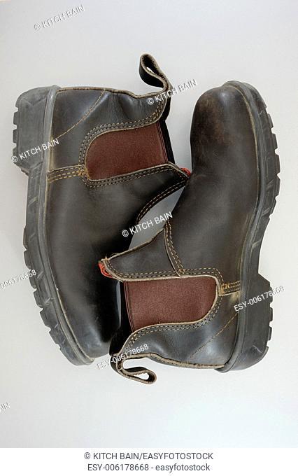 A close up shot of work boots