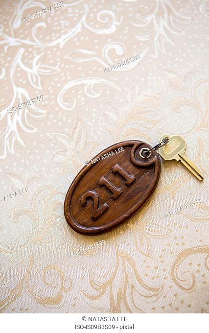 Hotel room key on numbered wooden keyring