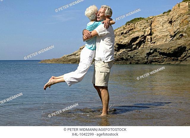 happy senior couple having fun on summer holiday
