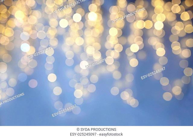 background, bokeh, holidays and backdrop concept - blue and yellow blurred christmas lights