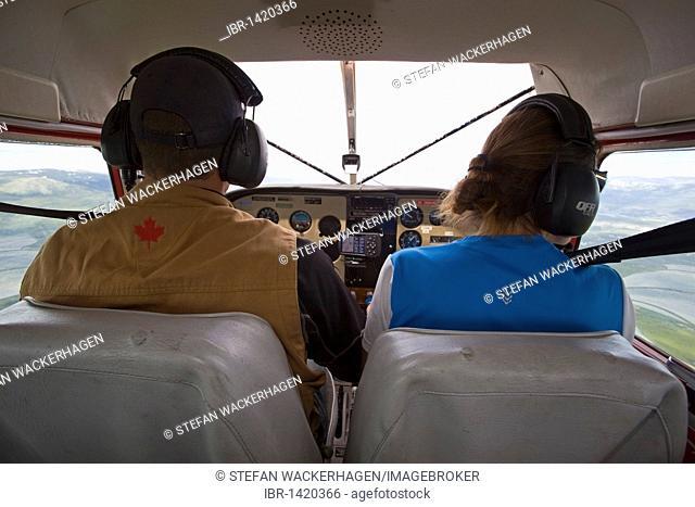 Pilot and co-pilot, cockpit of Float plane, bush plane, airborne, Cessna 180, Yukon Territory, Canada