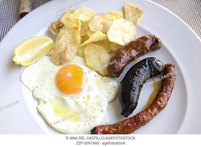 Spanish dish fried egg with sausages