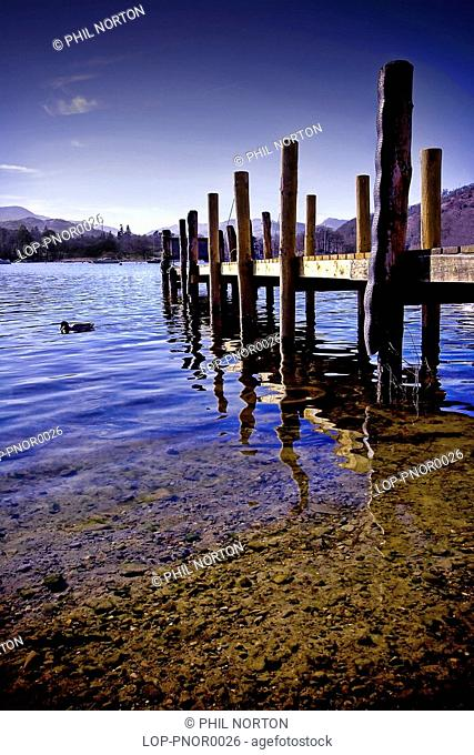 England, Cumbria, Windemere, A view of a wooden jetty at Lake Windemere