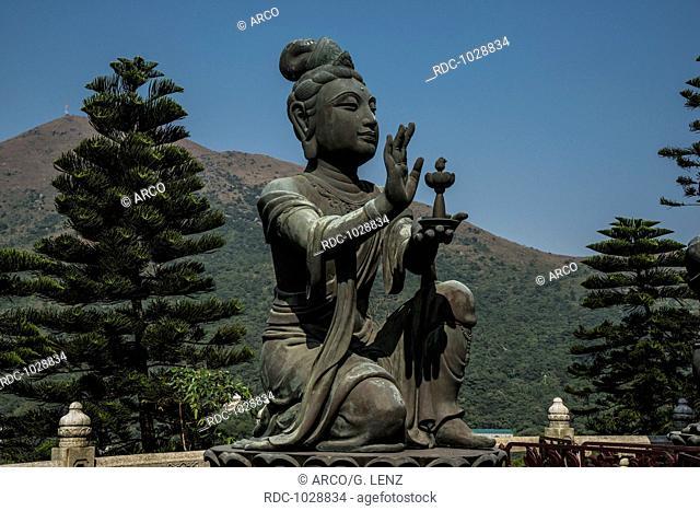 Buddhist statue praising Tian Tan Buddha or the Big Buddha, Lantau Island, Hong Kong, China, Asia
