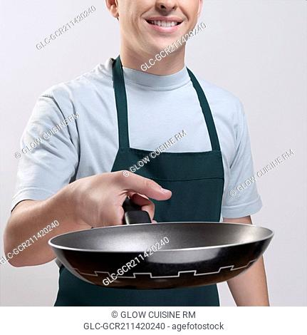 Man holding a frying pan