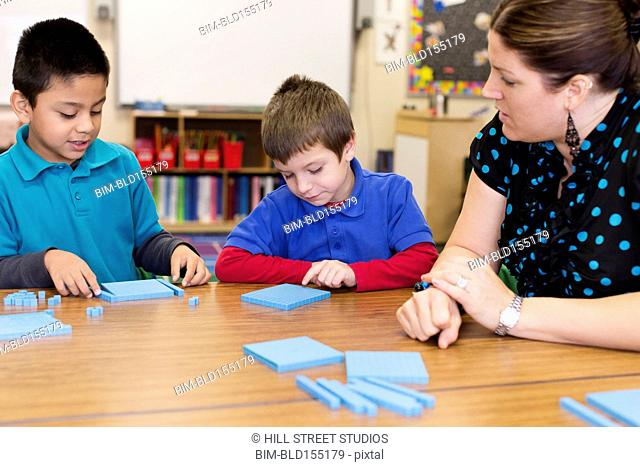 Students and teacher counting in classroom