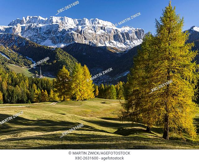 The Sella Mountain Range in the Dolomites of South Tyrol - Alto Adige , seen from the Groeden Valley - Val Gardena. The village Wolkenstein - Selva in the...