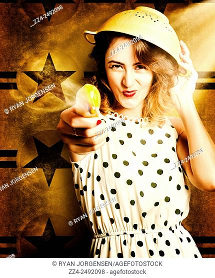 Cute and adorable retro pinup woman taking aim with a smoking banana gun and yellow colander helmet in a quick draw cooking concept