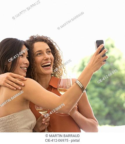 Friends taking pictures together outdoors