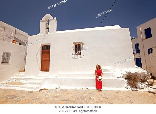 Woman in front of a chapel in the old town Chora, Amorgos, Cyclades Islands, Greek Islands, Greece, Europe