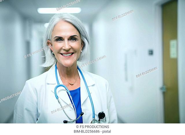 Portrait of smiling Caucasian doctor in hospital