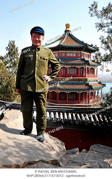 BEIJING - MARCH 14:An old Chinese man wearing Mao Tzetung suite and hat visit at the Summer Palace in Beijing, China on March 14 2007 Chairman Mao Zedong is...