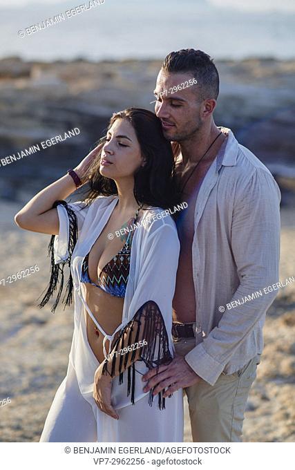 sensual couple enjoying togetherness at beach. Greek ethnicity. In holiday destination Hersonissos, Crete, Greece