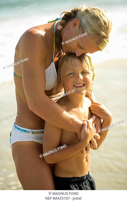 Scandinavian mother and son swimming