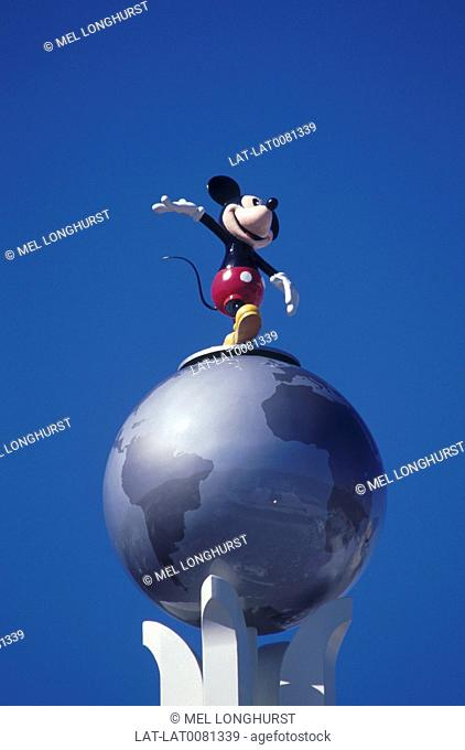 MGM studios. Globe. Statue of Mickey Mouse character. Against blue sky