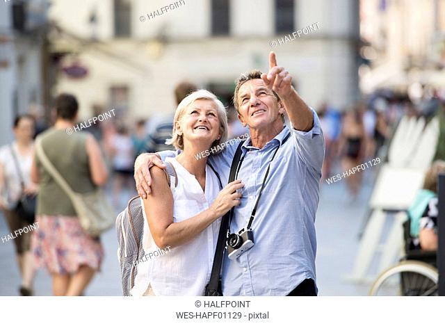 Senior couple on city trip