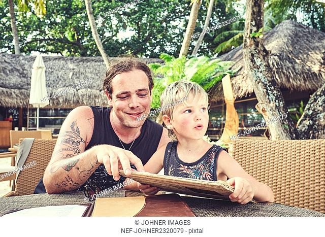 Father and son on summer holidays