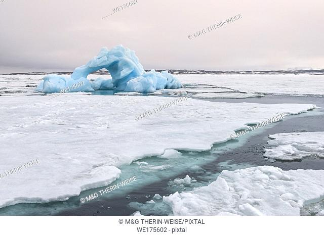 Blue Iceberg drifting in Hinlopen Strait, Spitsbergen Island, Svalbard archipelago, Norway