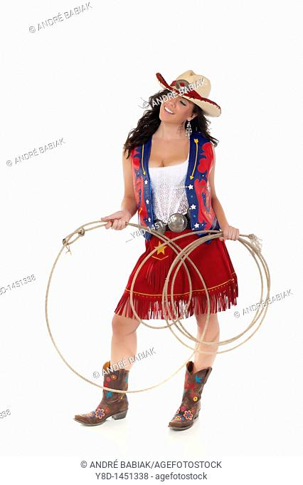 Young woman in cowgirl outfit holding rope
