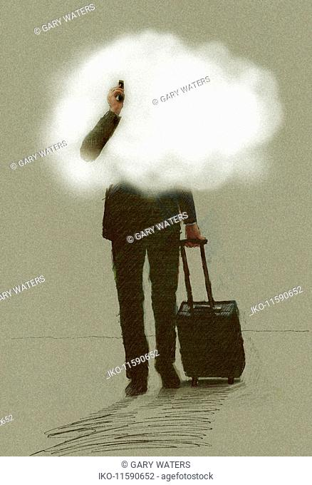 Businessman on the move using phone pulling suitcase with head in the clouds