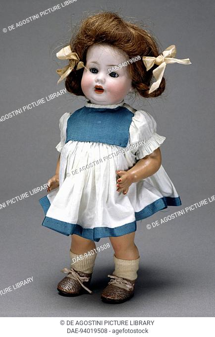Character doll with bisque head, real hair and papier mache body, branded MP. Germany, 20th century.  Milan, Museo Del Giocattolo E Del Bambino (Toys Museum)