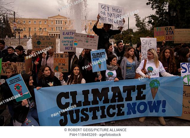 """Greek students during rally against climate change in front of Parliament. Banner """"""""Climatic Justice Now"""""""". 15.03.2019 