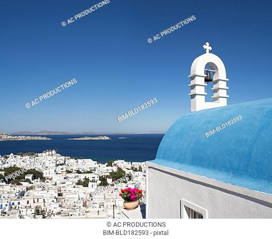 Traditional church and Mykonos cityscape, Cyclades, Greece