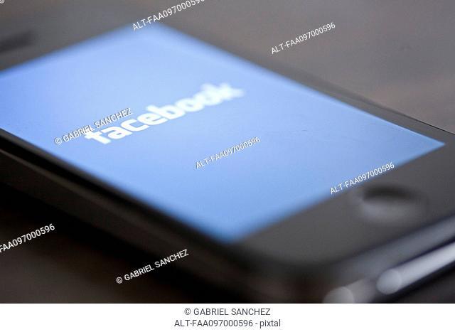 Close-up of smartphone displaying social media app