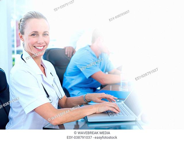 Female doctor working on laptop