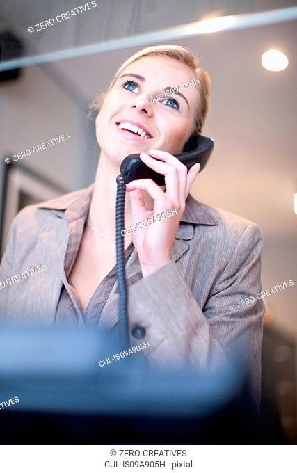 Receptionist talking on telephone