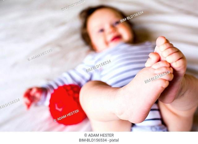 Close up of feet of Caucasian baby girl