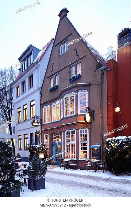 Inn Kleiner Olymp, Snowy old houses in the Schnoorviertel, Bremen, Germany, Europe