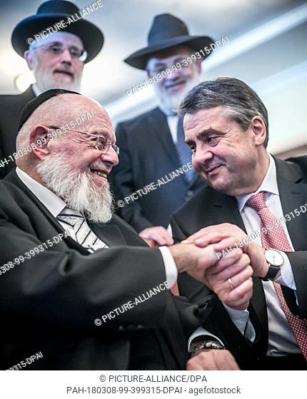 08 March 2018, Germany, Berlin: German Foreign Minister Sigmar Gabriel (R) of the Social Democratic Party (SPD) saying farewell to the rabbi Dayan Chanoch...