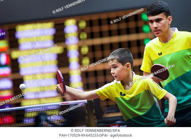 Ilyas Allanazarov (L), 9, from Turkmenistan, the tournament's youngest player, playing in a men's doubles qualifier beside his partner Didar Shaymanov