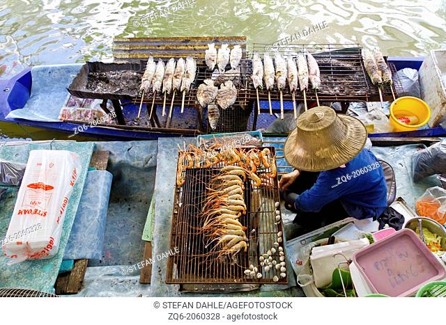 Sale of Food on a Boat on the floating Market of Taling Chan in Bangkok, Thailand