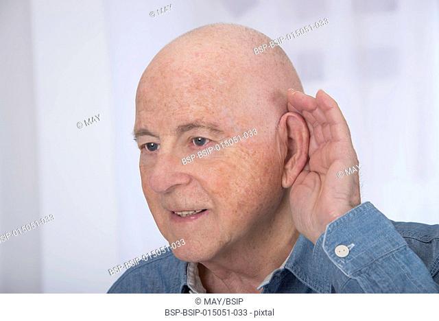 Senior man with hearing disorders