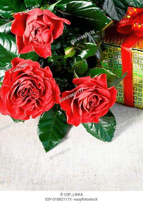 three red roses and gift