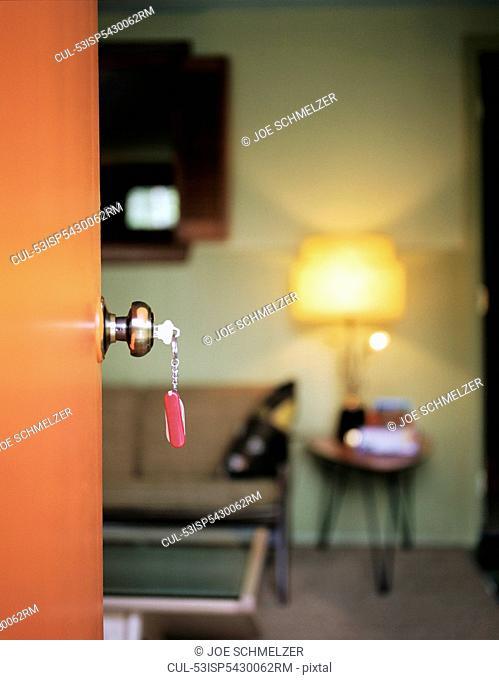 Key in hotel room doorknob