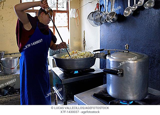 Nun cooking, in Geden Choeling Nunnery, McLeod Ganj, Dharamsala, Himachal Pradesh state, India, Asia