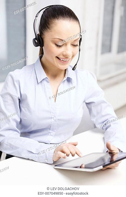 business, communication and call center concept - friendly female helpline operator with headphones and tablet pc comupter