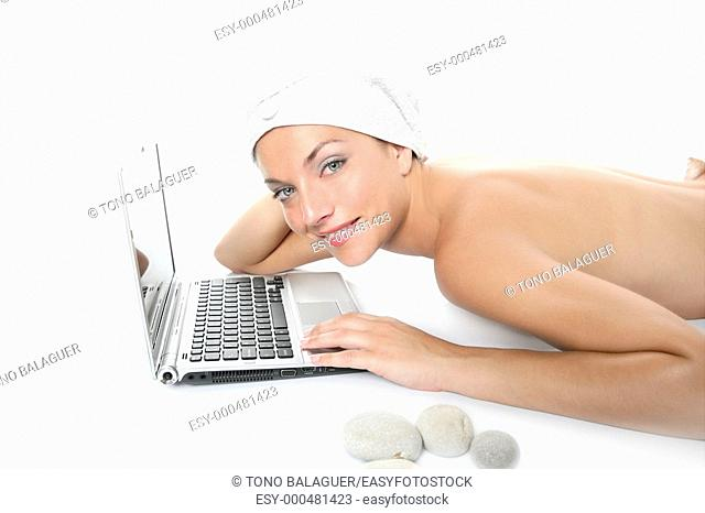 Beautiful woman in spa working with laptop computer
