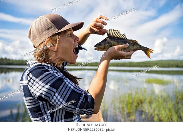 Woman holding fish