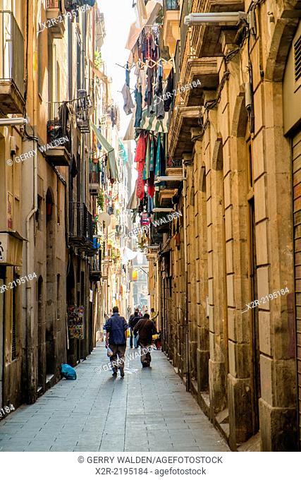 A narrow side street leading to La Rambla in Barcelona, Spain