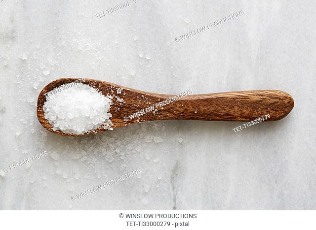 Overhead view of wooden spoon with sea salt