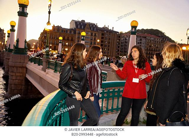 Group of tourists and guide making a tour of the city, La Zurriola bridge, Urumea river, Donostia, San Sebastian, Gipuzkoa, Basque Country, Spain, Europe