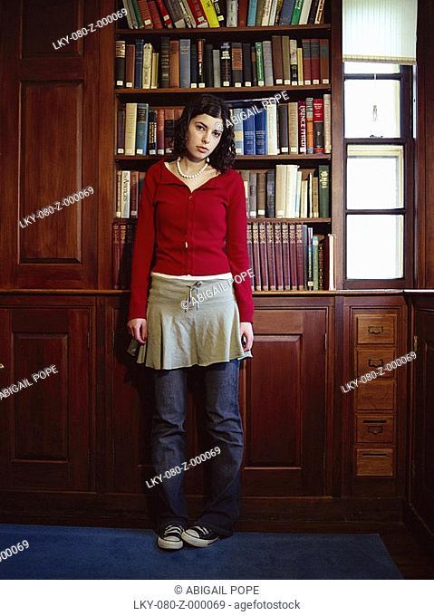Portrait of teen girl standing in study